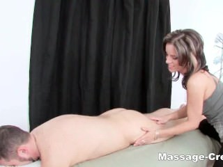 Oiled brunette blowjob after massage