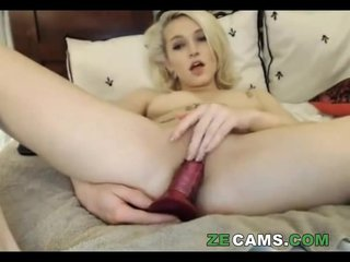Tattoo blonde masturbating