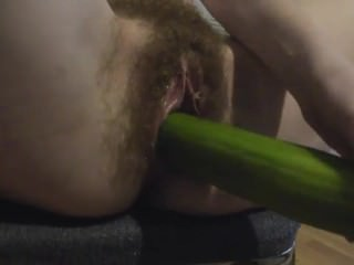 Hairy girl Masturbates cucumber